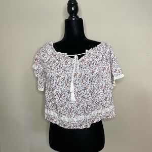 American Eagle floral blouse with lace trim and fringe tie in the front